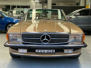 1986 Mercedes-Benz 560SL R107 Gold Automatic Convertible.