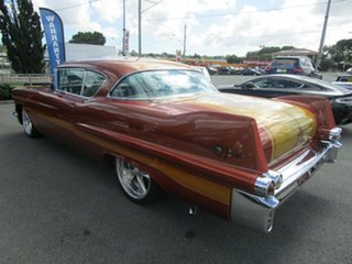 1957 Cadillac Coupe Deville Gold Coupe.