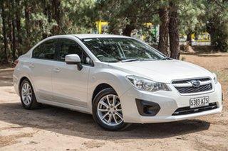 2013 Subaru Impreza G4 MY13 2.0i AWD White 6 Speed Manual Hatchback.