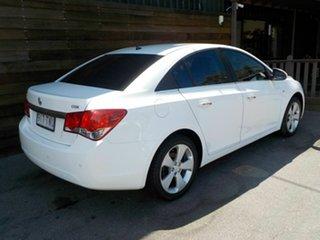 2010 Holden Cruze JG CDX White 5 Speed Manual Sedan.