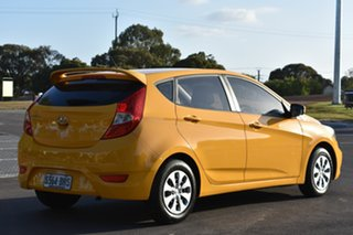 2015 Hyundai Accent RB2 MY15 Active Yellow 4 Speed Sports Automatic Hatchback.
