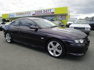 2004 Holden Monaro V2 Series III CV8 Purple 4 Speed Automatic Coupe.