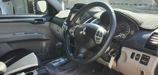2014 Mitsubishi Challenger PC MY14 LS (5 Seat) (4x4) White 5 Speed Automatic Wagon.