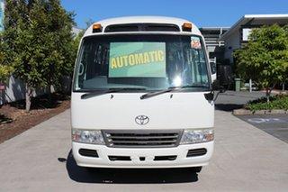 2013 Toyota Coaster Deluxe White Automatic Midi Coach.