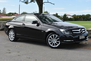2012 Mercedes-Benz C-Class C204 C180 BlueEFFICIENCY 7G-Tronic + Black 7 Speed Sports Automatic Coupe