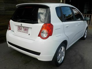 2011 Holden Barina TM White 6 Speed Automatic Hatchback.