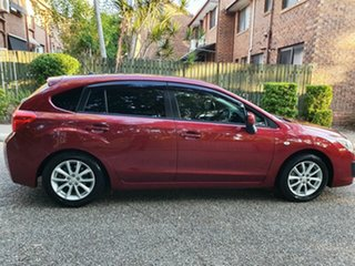 2014 Subaru Impreza MY14 2.0I-L (AWD) Red Continuous Variable Hatchback.