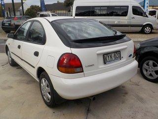 1997 Ford Laser KJ III (KM) GLXi White 4 Speed Automatic Hatchback.