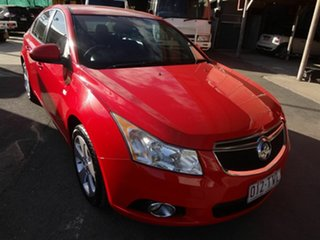 2014 Holden Cruze JH MY14 Equipe Red 5 Speed Manual Sedan.