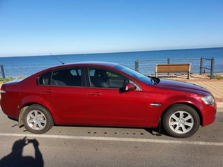 2009 Holden Commodore VE MY09.5 Omega Red Pearl 4 Speed Automatic Sedan.