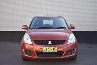 2012 Suzuki Swift FZ GL Orange 4 Speed Automatic Hatchback.