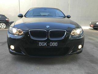2009 BMW 325i E93 MY09 Black 6 Speed Auto Steptronic Convertible.