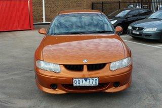 2001 Holden Commodore VX S Orange 4 Speed Automatic Sedan.