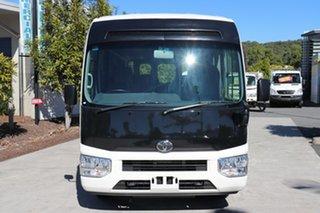 2017 Toyota Coaster Deluxe White Automatic Midi Coach.