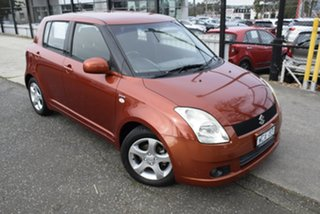 2007 Suzuki Swift RS415 S Orange 5 Speed Manual Hatchback.