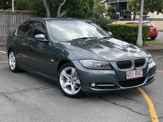 2011 BMW 3 Series E90 MY11 320i Steptronic Lifestyle Green 6 Speed Sports Automatic Sedan.