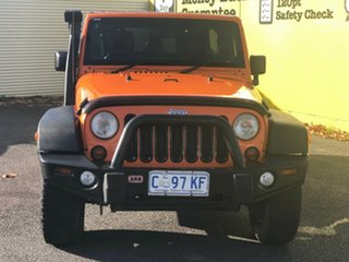 2012 Jeep Wrangler JK MY2012 Unlimited Sport Orange 6 Speed Manual Softtop