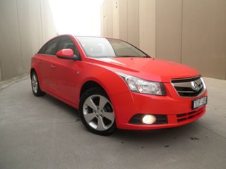 2009 Holden Cruze JG CDX Sting Red 5 Speed Manual Sedan.