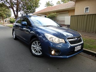2012 Subaru Impreza G4 MY12 2.0i-L AWD Blue 6 Speed Manual Hatchback.