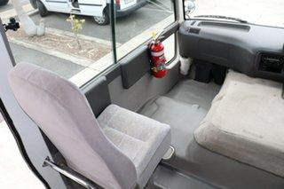 2004 Toyota Coaster LWB Standard French Vanilla Manual Midi Coach