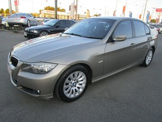 2008 BMW 3 Series E90 MY09 320i Steptronic Executive Gold 6 Speed Sports Automatic Sedan.