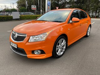2013 Holden Cruze JH Series II MY14 SRi-V Orange 6 Speed Manual Hatchback.
