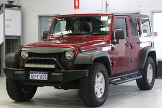 2011 Jeep Wrangler Unlimited JK MY09 Sport (4x4) Red 4 Speed Automatic Softtop.