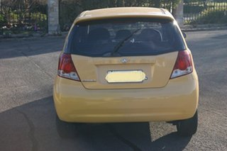 2006 Holden Barina TK Yellow 5 Speed Manual Hatchback.
