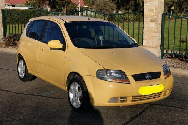 Used Holden Barina TK , 2006 Holden Barina TK Yellow 5 Speed Manual Hatchback