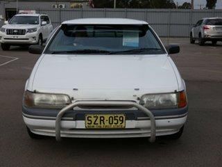 1994 Ford Falcon ED GLi White 4 Speed Automatic Sedan.