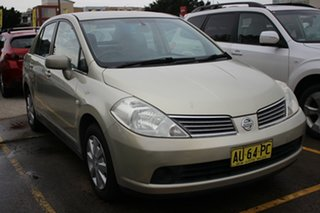 2006 Nissan Tiida C11 ST Gold 4 Speed Automatic Sedan.