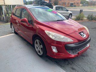 2009 Peugeot 308 XSE HDi Red 4 Speed Automatic Wagon.