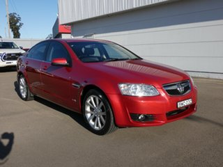 2011 Holden Berlina VE II Red 4 Speed Automatic Sedan.