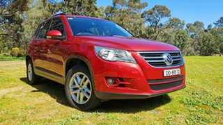 2010 Volkswagen Tiguan 5N MY10 103TDI 4MOTION Red 6 Speed Sports Automatic Wagon.