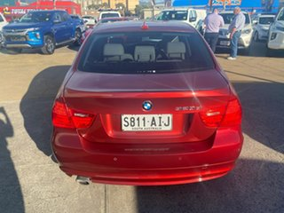 2010 BMW 3 Series E90 MY11 320d Steptronic Lifestyle Red 6 Speed Sports Automatic Sedan