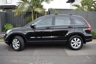 2011 Honda CR-V RE MY2011 4WD Black 6 Speed Manual Wagon.