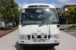 2012 Toyota Coaster LWB Standard White Manual Midi Coach.
