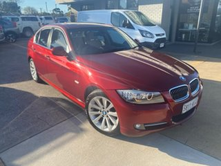 2010 BMW 3 Series E90 MY11 320d Steptronic Lifestyle Red 6 Speed Sports Automatic Sedan.
