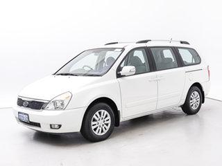 2010 Kia Grand Carnival VQ MY11 SI White 6 Speed Automatic Wagon.
