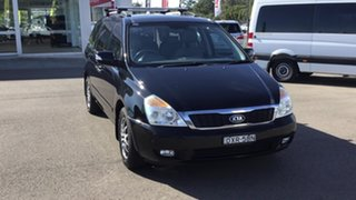 2010 Kia Grand Carnival VQ MY11 SLi Black 6 Speed Sports Automatic Wagon.