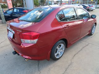 2009 Honda City VTi Red Automatic Sedan.