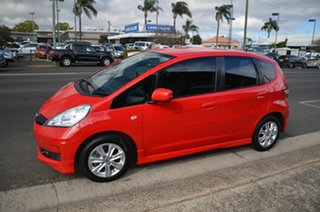 2013 Honda Jazz GE MY12 VTi Red 5 Speed Automatic Hatchback.