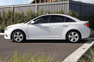 2011 Holden Cruze White Sedan.