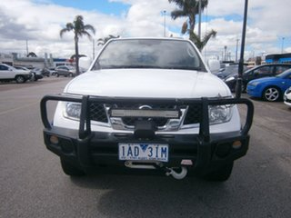 2012 Nissan Navara D40 S6 MY12 RX King Cab White 6 Speed Manual Cab Chassis.