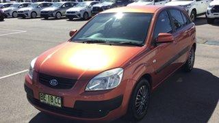 2009 Kia Rio JB MY09 LX Orange 5 Speed Manual Hatchback.