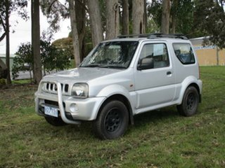 2001 Suzuki Jimny SN413 Silver Manual Wagon.