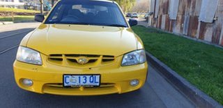 2002 Hyundai Accent LC GL Yellow 5 Speed Manual Hatchback.