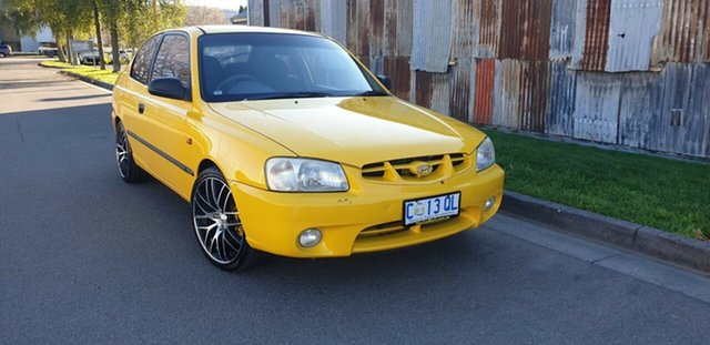 Used Hyundai Accent LC GL Launceston, 2002 Hyundai Accent LC GL Yellow 5 Speed Manual Hatchback