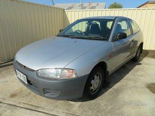 1997 Mitsubishi Mirage Silver 5 Speed Manual Hatchback.