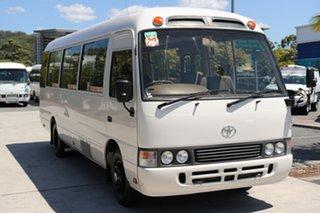 1994 Toyota Coaster LWB Standard White Manual Midi Coach.